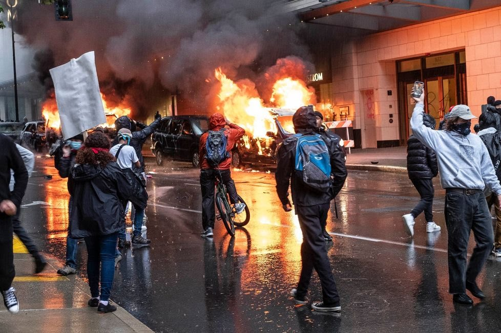 Rioters set fire to vehicles during a George Floyd protest in Seattle, Washington on May 30.