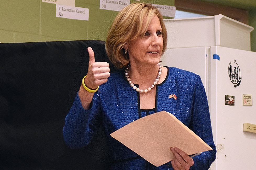 Republican Congresswoman Claudia Tenney signals she successfully cast her ballot after voting at St. George's Church in New Hartford, N.Y.